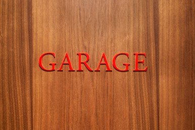 Door with Garage sign in red letters